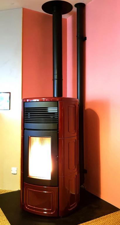 Poêle granulé étanche MCZ Suite Comfort Air 12kW / conduit + canalisation d'air chaud
