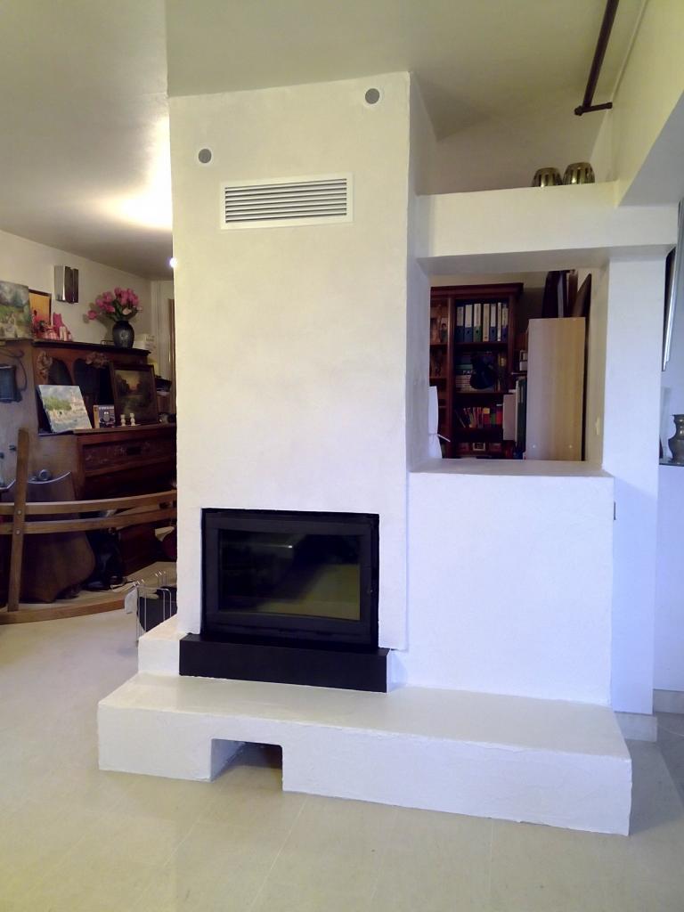 Trou à feu rénové avec foyer FonteFlamme