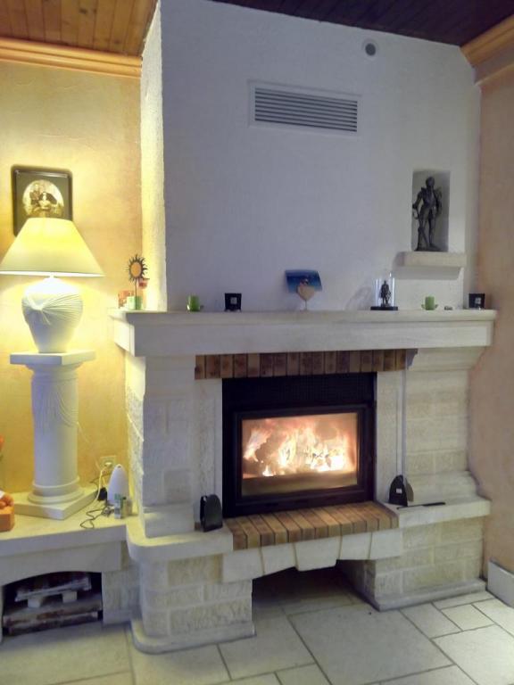 Rénovation complète (isolation hotte + foyer + gainage)